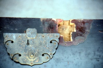 Detail of lockplate needing repairs
